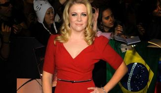 "** FILE ** Melissa Joan Hart arrives at the world premiere of ""The Twilight Saga: Breaking Dawn,"" Nov. 14, 2011, in Los Angeles. (Associated Press)"