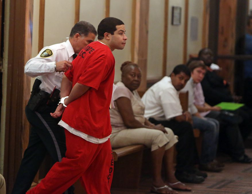Eric Rivera Jr. is moved through the hallway to the courtroom holding room on Friday, Nov. 1, 2013, during the third day of deliberations in the Sean Taylor murder trial in Miami. Rivera is accused of fatally shooting Washington Redskins star Sean Taylor. (AP Photo/The Miami Herald, Walter Michot)  MAGS OUT