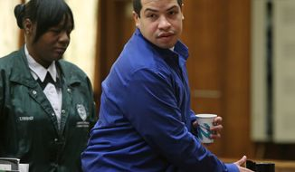 Eric Rivera Jr. leaves the courtroom on Friday, Nov. 1, 2013, in Miami. A South Florida jury resumed deliberations in Rivera's case Friday. Rivera has been charged in the fatal shooting of Washington Redskins star Sean Taylor during an ill-fated 2007 burglary. (AP Photo/The Miami Herald, Walter Michot)  MAGS OUT