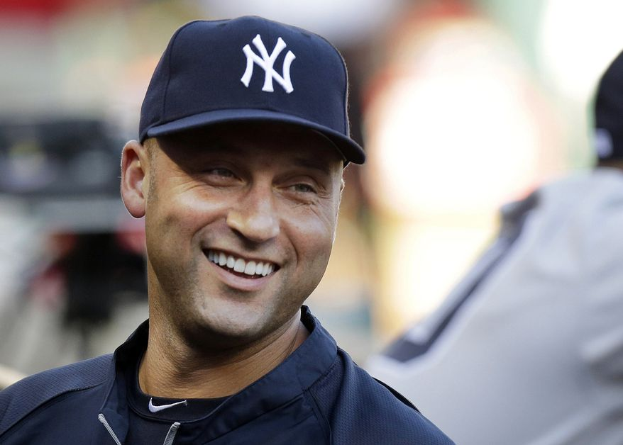 FILE - In this July 22, 2013, file photo, New York Yankees shortstop Derek Jeter laughs while standing in the dugout with teammates during a baseball game against the Texas Rangers in Arlington, Texas. Jeter and the Yankees have agreed to a $12 million, one-year contract on Friday, Nov. 1, 2013.  (AP Photo/LM Otero, File)