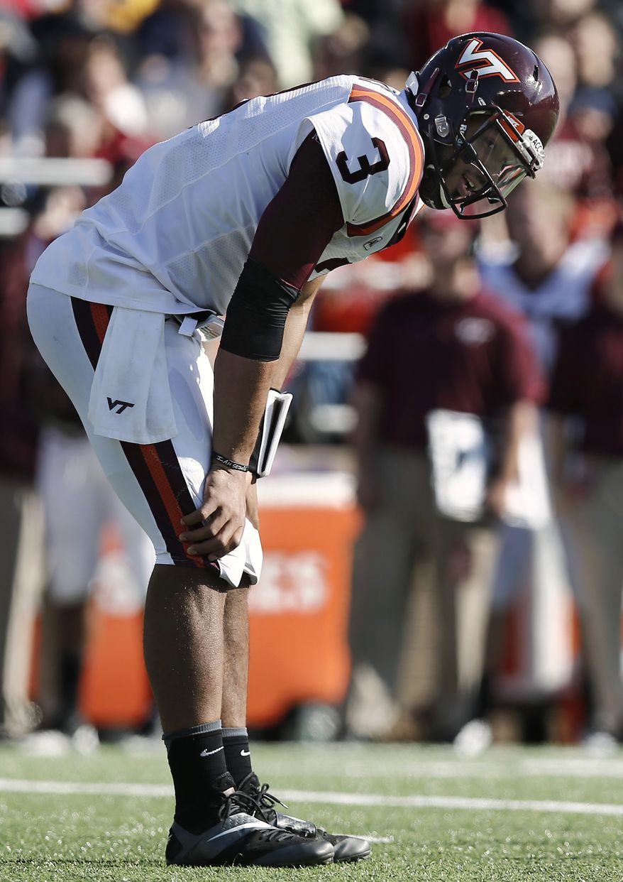 Virginia Tech quarterback Logan Thomas leans on his knees after a touchdown was called back on a penalty during the first half of Tech's 34-27 loss to Boston College in an NCAA college football game at Alumni Stadium in Boston, Saturday, Nov. 2, 2013. (AP Photo/Winslow Townson)