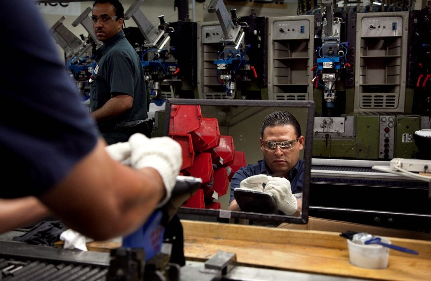 Renaldo Escobar works on the assembly line of a shoe factory in Boston. Obama economic adviser Jason Furman has said that millions of Americans lack the skills and education to demand higher wages. (Associated Press)
