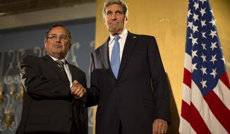 U.S. Secretary of State John F. Kerry (right) shakes hands with Egyptian Foreign Minister Nabil Fahmy at their press conference in Cairo on Sunday, Nov. 3, 2013. Mr. Kerry is in Egypt to press for reforms during the highest-level American visit to that country since the ouster of the nation's first democratically elected president, Mohammed Morsi, in July. (AP Photo/Jason Reed, Pool)
