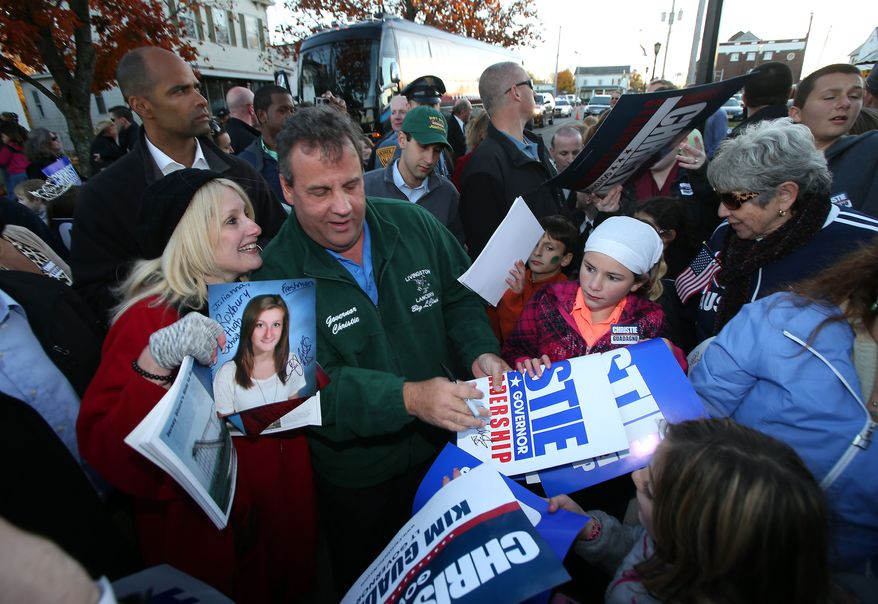 New Jersey Gov. Chris Christie signs autographs after making a campaign stop at the Sussex County GOP Headquarters in Newton Sunday, Nov. 3, 2013.  (AP Photo/New Jersey Herald, Daniel Freel)