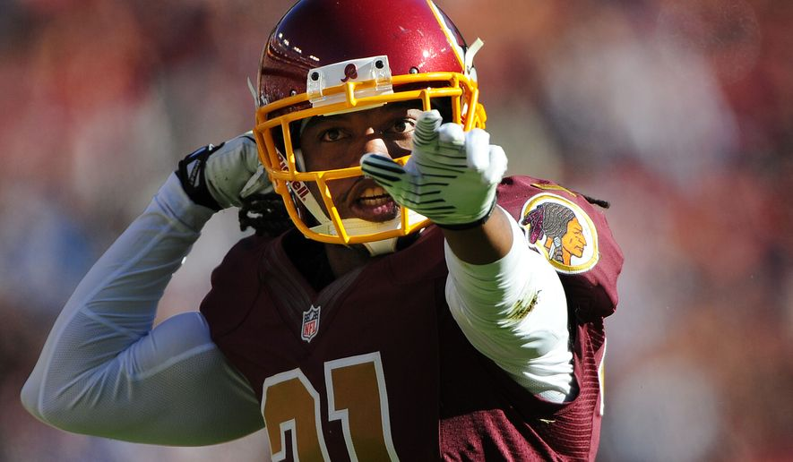Washington Redskins strong safety Brandon Meriweather (31) celebrates a big hit on San Diego Chargers running back Danny Woodhead (39) in the second quarter at FedExField, Landover, Md., November 3, 2013. (Preston Keres/Special for The Washington Times)