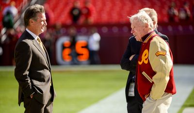 Washington Redskins General Manager Bruce Allen, left, talks with former Redskins General Manager Bobby Beathard, right, as Redskins alumni are welcomed to the field before the Washington Redskins play the San Diego Chargers at FedExField, Landover, Md., Sunday, November 3, 2013. (Andrew Harnik/The Washington Times)