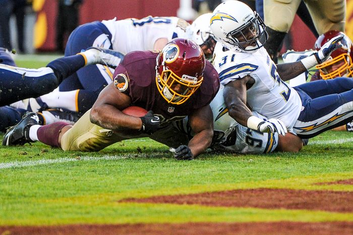 Washington Redskins fullback Darrel Young (36) scores on a 4 yard rush in overtime to beat the San Diego Chargers in overtime 30-24 at FedExField, Landover, Md., Sunday, November 3, 2013. (Andrew Harnik/The Washington Times)