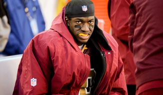 Washington Redskins quarterback Robert Griffin III (10) sits on the sideline in the fourth quarter as the Washington Redskins play the San Diego Chargers at FedExField, Landover, Md., Sunday, November 3, 2013. (Andrew Harnik/The Washington Times)