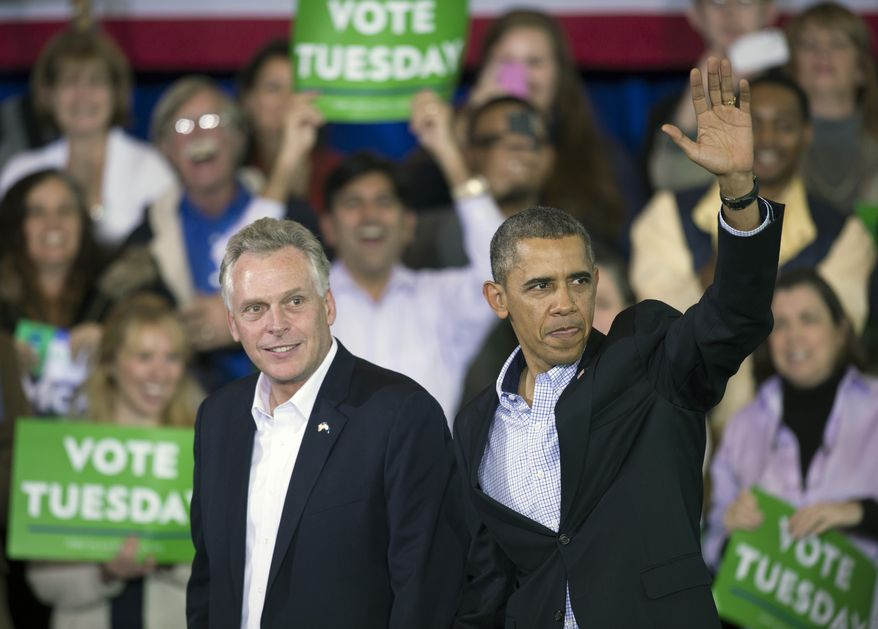 President Obama appears at a campaign rally with supporters for Virginia Democratic gubernatorial candidate Terry McAuliffe (left) at Washington-Lee High School in Arlington, Va., on Sunday, Nov. 3, 2013. (AP Photo/Cliff Owen)
