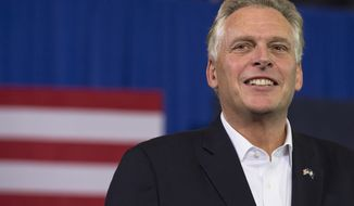 Virginia Democratic gubernatorial candidate Terry McAuliffe smiles during his campaign event at Washington-Lee High School in Arlington, Va. on Sunday, Nov. 3, 2013. President Barack Obama also attended the event. (AP Photo/Jacquelyn Martin)