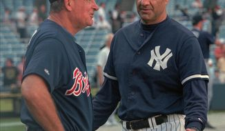 New York Yankees manager Joe Torre, right, and Atlanta Braves manager Bobby Cox chat on the field at Yankee Stadium before their interleague game Monday June 30, 1997 in New York. The Yanks beat the Braves in last year's World Series. (AP Photo/Ron Frehm)