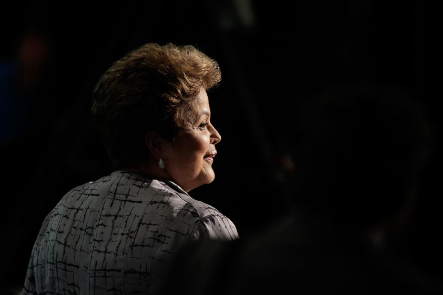 FILE - In this Oct. 8, 2013 file photo, Brazil's President Dilma Rousseff leaves the opening of a global conference in Brasilia, Brazil. The Brazilian government confirmed Monday, Nov. 4, 2013, that its intelligence service targeted U.S., Russian, Iranian and Iraqi diplomats and property during spy activities carried out about a decade ago in the capital Brasilia. (AP Photo/Eraldo Peres, File)