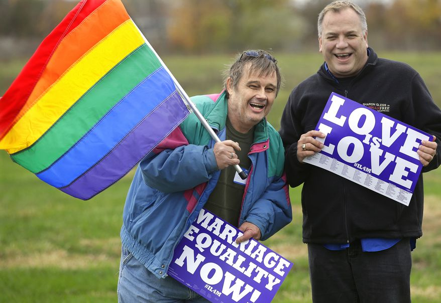 Jerry Bowman, left, and David Strzepek join other supporters of Social Security benefits for same sex couples during a marriage equality rally Monday, Nov. 4, 2013, in Springfield, Ill. Illinois lawmakers return to the Capitol Tuesday for the final week of veto session and are expected to consider gay marriage legislation. (AP Photo/Seth Perlman)
