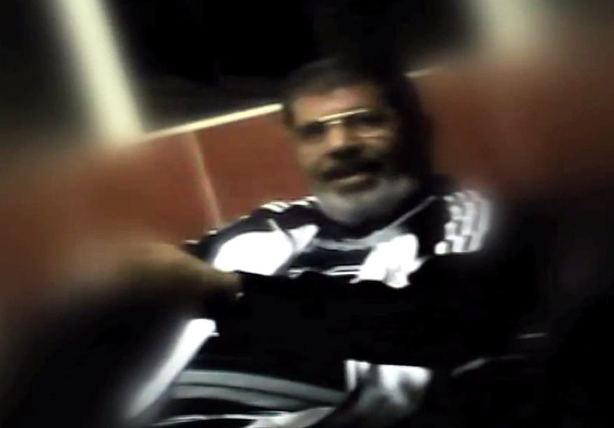 This image made from undated video posted on the website of the el-Watan newspaper on Sunday, Nov. 3, 2013, shows ousted President Mohammed Morsi during his detention at an undisclosed facility in Egypt following his ouster. A newspaper known for close ties to the military published what appeared to be the first pictures of Morsi from his detention. (AP Photo/el-Watan Newspaper via AP video)