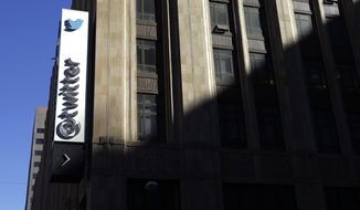 This photo shows the sign outside of Twitter headquarters in San Francisco, Monday, Nov. 4, 2013. Seven years after co-founder Jack Dorsey sent the first tweet through the online messaging service, more than 500 million posts are shared each day by everyone from the Dalai Lama to Justin Bieber. (AP Photo/Jeff Chiu)