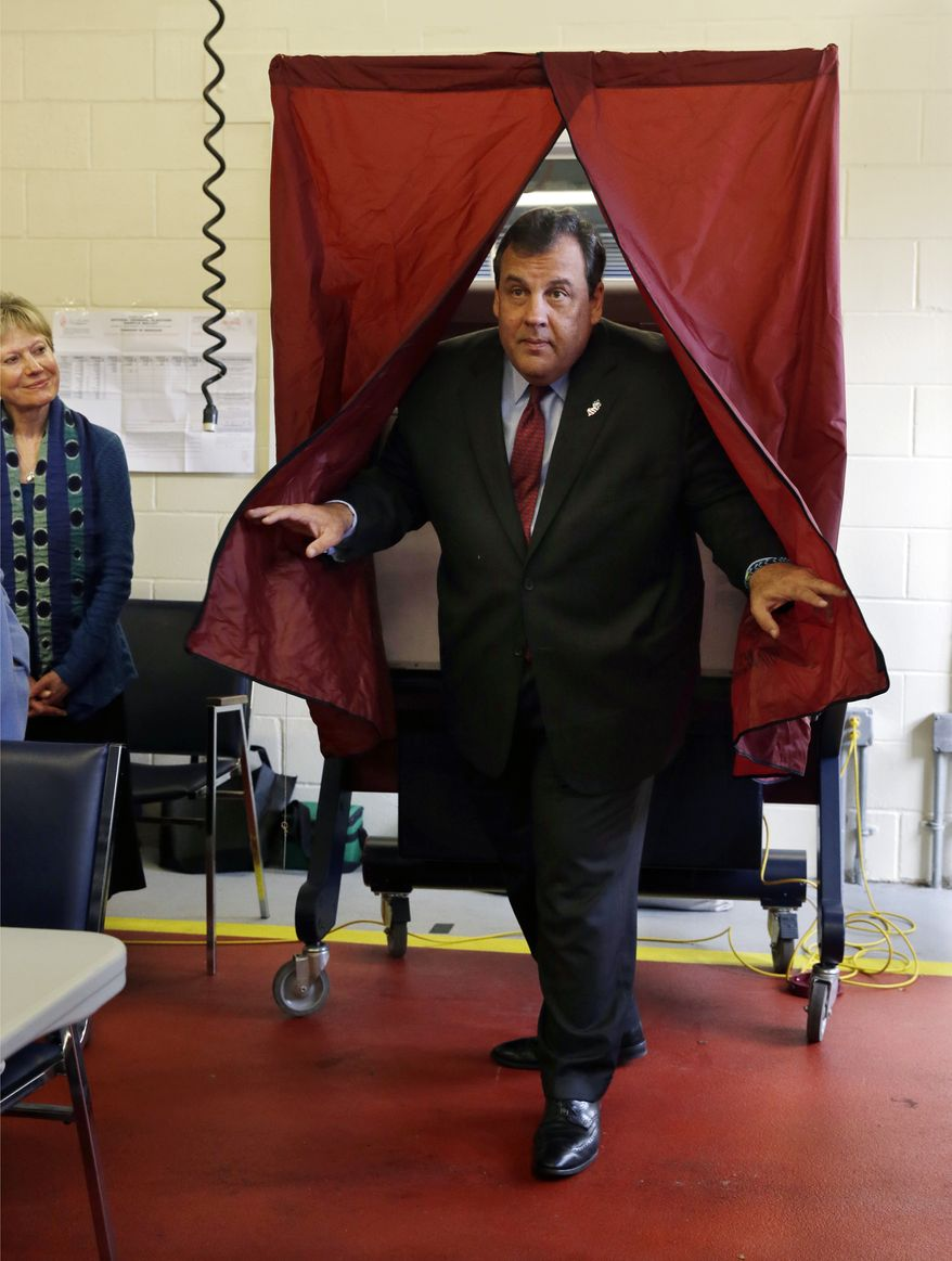 Republican New Jersey Gov. Chris Christie steps from the booth after voting in Mendham Township, N.J., Tuesday, Nov. 5, 2013. Christie is facing Democratic challenger Barbara Buono in Tuesday's election. (AP Photo/Mel Evans)