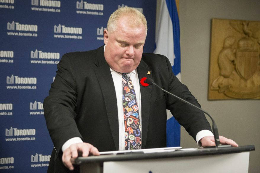 "Toronto Mayor Rob Ford addresses the media at City Hall in Toronto, Tuesday, Nov. 5, 2013.  Ford acknowledged for the first time that he smoked crack ""probably a year ago,"" when he was in a ""drunken stupor,"" but he refused to resign despite immense pressure to step aside as leader of Canada's largest city. Allegations that the mayor had been caught on video smoking crack surfaced in news reports in May. Ford initially insisted the video didn't exist, sidestepped questions about whether he had ever smoked crack and rebuffed growing calls to step down.  (AP Photo/The Canadian Press, Chris Young)"