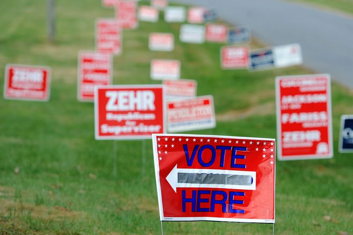 Political campaign signs line the streets and direct voters to the polls at the New Chapel Baptist Church, Tuesday, Nov. 5, 2013 in Rustburg, Va.  Democrat Terry McAuliffe and Republican Ken Cuccinelli are running succeed term-limited Gov. Bob McDonnell for a four year term starting