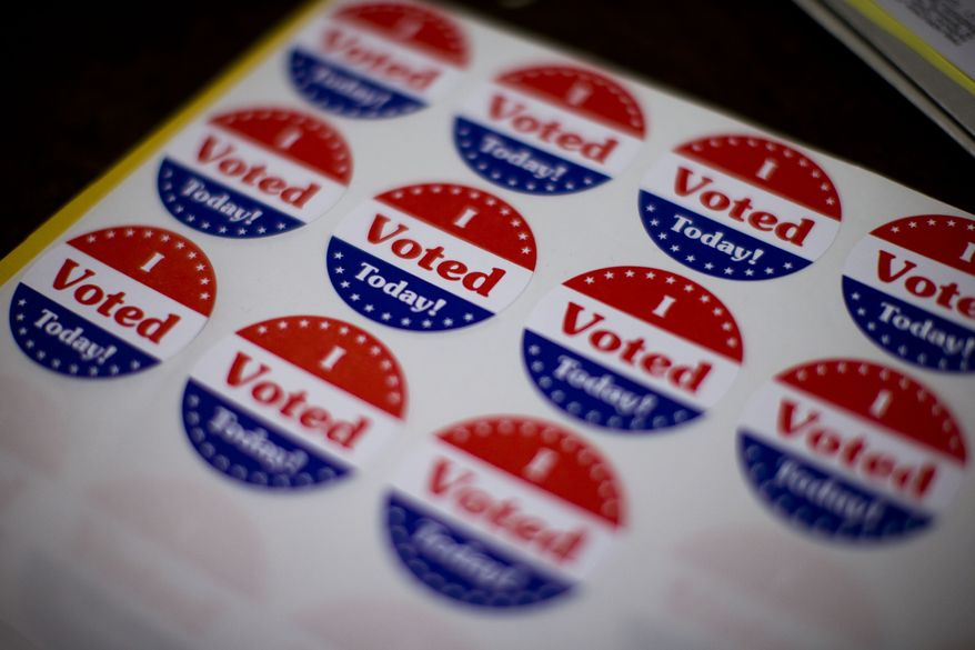 Stickers wait for voters at a polling place in the Oregon New Years Association, Tuesday, Nov. 5, 2013, in Philadelphia. Turnout was reported as light Tuesday across Pennsylvania as voters headed to the polls in an off-year election with few high-profile contests. (AP Photo/Matt Rourke)