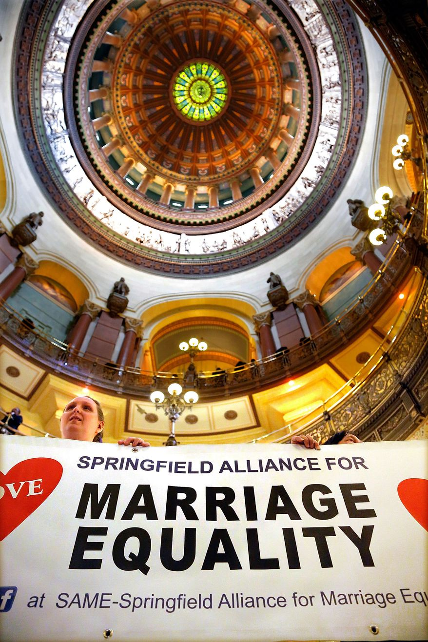 Supporters of same sex marriage legislation rally in the rotunda at the Illinois State Capitol during veto session Tuesday, Nov. 5, 2013 in Springfield Ill. Illinois lawmakers  are expecting to consider gay marriage legislation during this week's veto session. (AP Photo/Seth Perlman)