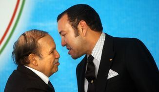 ** FILE ** This March 22, 2005, file photo shows Algerian President Abdelaziz Bouteflika, left, listening to Morocco King Mohammed VI  prior to the opening  session of the 17th League of Arab States' summit in Algiers, Algeria. (AP Photo/Amr Nabil, file)