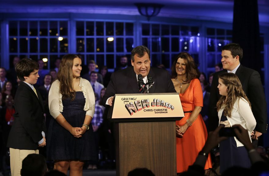 Republican New Jersey Gov. Chris Christie reacts to shouts from the crowd as he stands with his wife Mary Pat Christie, center right, and their children, Andrew, back right, Bridget, front right, Patrick, left, and Sarah, second left,  as they celebrate his election victory in Asbury Park, N.J., Tuesday, Nov. 5, 2013, after defeating Democratic challenger Barbara Buono . (AP Photo/Mel Evans)