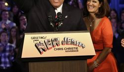 Republican New Jersey Gov. Chris Christie waves as he stands with his wife Mary Pat Christie as they celebrate his election victory in Asbury Park, N.J., Tuesday, Nov. 5, 2013, after defeating Democratic challenger Barbara Buono . (AP Photo/Mel Evans)