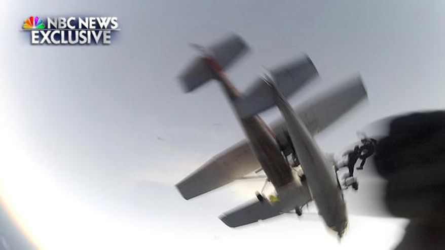 Still image obtained by NBC News showing the moment when two Cessnas collided in midair. The skydivers and both pilots survived.