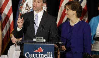 Virginia Attorney General Kenneth T. Cuccinelli II, the Republican gubernatorial candidate, delivers his concession speech with his wife, Teiro, during an election-night party in Richmond on Tuesday, Nov. 5, 2013. Mr. Cuccinelli lost to Democrat Terry McAuliffe. (AP Photo/Steve Helber)