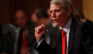 """""""My amendment prohibits the government from punishing a religious institution  and thereby seeks to keep the state from interfering in matters of faith,"""" Sen. Rob Portman, Ohio Republican says of the ENDA bill. (ASSOCIATED PRESS)"""