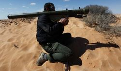 Libyan rebels were armed with SA-7s to help topple dictator Moammar Gadhafi, but weapons merchants have set up large operations with no interference. (Associated Press)