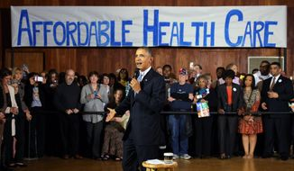 **FILE** President Barack Obama speaks at Temple Emanu-El on Nov. 6, 2013, in Dallas, as he promotes his health care law. (Associated Press/The Dallas Morning News, Louis DeLuca)