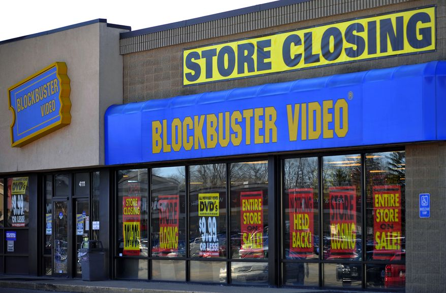 ** FILE ** This March 17, 2010, file photo, shows a closing Blockbuster stores in Racine, Wis. Dish Network announced Wednesday, Nov. 6, 2013, it will close the remaining 300 Blockbuster locations scattered across the United States. Dish Network expects the stores to be closed by early January. Dish Network says about 2,800 people will lose their jobs. (AP Photo/Journal Times, Scott Anderson, File)