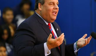 New Jersey Gov. Chris Christie talks to the media as he visits Jose Marti Freshman Academy in Union City, N.J., on Wednesday, Nov. 6, 2013, the day after defeating state Sen. Barbara Buono, his Democratic challenger, to win his second term as governor. (AP Photo/Rich Schultz)