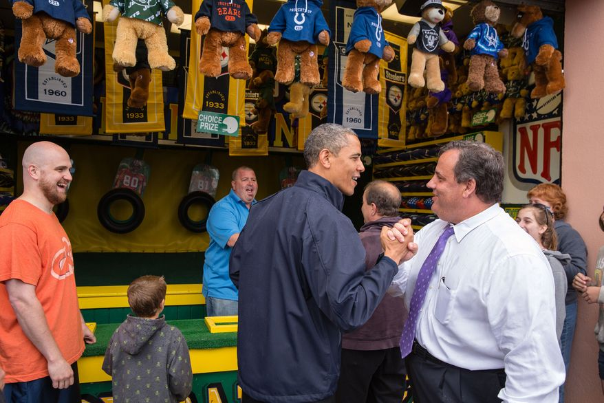 """President Barack Obama congratulates New Jersey Governor Chris Christie while playing the """"TouchDown Fever"""" arcade game along the Point Pleasant boardwalk in Point Pleasant Beach, N.J., May 28, 2013. (Official White House Photo by Pete Souza)"""