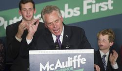 Virginia Democratic Gov.-elect Terry McAuliffe address his supporters, as his sons Jack, 20, left, and Peter, 11, right, look on, during an election victory party at Tysons Corner, Va., Wednesday, Nov. 6, 2013. (AP Photo/Cliff Owen)