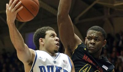 Duke's Seth Curry (30) drives to the basket against Maryland's Shaquille Cleare (44) during the first half of an NCAA college basketball game in Durham, N.C., Saturday, Jan. 26, 2013. (AP Photo/Gerry Broome)