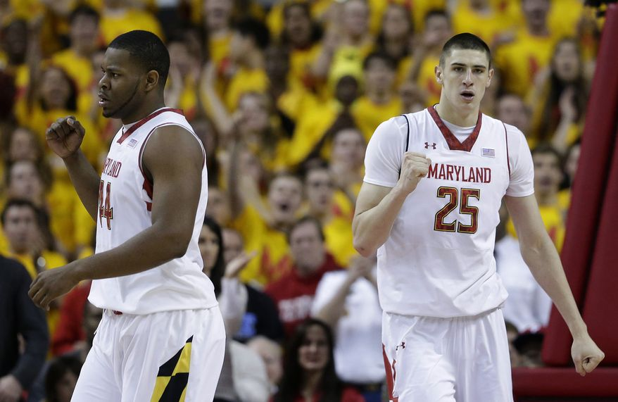 Maryland center Shaquille Cleare, left, of the Bahamas, and Maryland center Alex Len, of Ukraine, react after Len deflected a shot attempt by Duke forward Mason Plumlee in the second half of an NCAA college basketball game in College Park, Md., Saturday, Feb. 16, 2013. Maryland won 83-81. (AP Photo/Patrick Semansky)