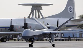 ** FILE ** In this Nov. 8, 2011, file photo, a Predator B unmanned aircraft taxis at the Naval Air Station in Corpus Christi, Texas. (AP Photo/Eric Gay, File)