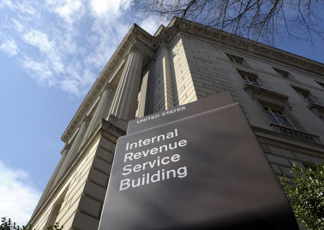 This photo taken March 22, 2013, shows the exterior of the Internal Revenue Service (IRS) building in Washington. The IRS issued $4 billion in fraudulent tax refunds last year to people using stolen identities, with some of the money going to addresses in Bulgaria, Lithuania and Ireland, according to a Treasury report release