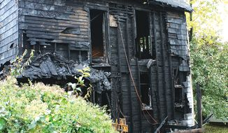 The back of a Louisiana, Mo., house in which 3-year-old Riley Jeffrey Rieser was killed in a fire is pictured on Thursday, Oct. 31, 2013. The child's mother and stepfather were outraged after police used a stun gun on the man as he tried to run back in and save the boy. (AP Photo/Louisiana Press-Journal, Tim Schmidt)