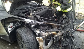 Emergency workers respond to a fire in a Tesla Model S electric car in Smyrna, Tenn., on Wednesday, Nov. 6, 2013. (AP Photo/Tennessee Highway Patrol)