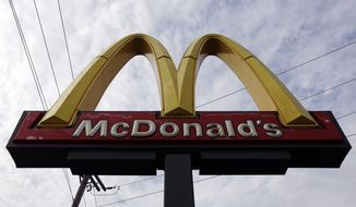 A McDonald's sign towers above one of the fast-food chain's restaurants in Chicago on Friday, Oct. 4, 2013. (AP Photo/Nam Y. Huh)