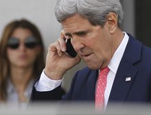 """U.S. Secretary of State John Kerry speaks on a mobilephone after meeting with Israeli Prime Minister Benjamin Netanyahu in Tel Aviv, Israel, Friday, Nov. 8, 2013. Netanyahu, before meeting with Kerry, said Friday that he """"utterly rejects"""" the emerging nuclear deal between western powers and Iran, calling it a """"bad deal"""" and promising that Israel will do everything it needs to do to defend itself. (AP Photo/Jason Reed, Pool)"""