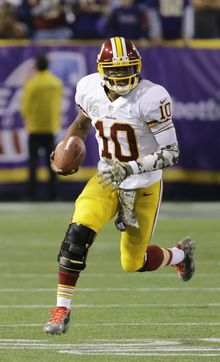 Washington Redskins quarterback Robert Griffin III scrambles for yardage during the second half of an NFL football game against the Minnesota Vikings, Thursday, Nov. 7, 2013, in Minneapolis. The Vikings won 34-27. (AP Photo/Ann Heisenfelt)