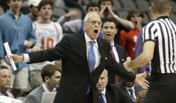 SMU head coach Larry Brown, left, yells at a referee during the first half of an NCAA college basketball game against TCU in Dallas, Friday, Nov. 8, 2013. (AP Photo/LM Otero)