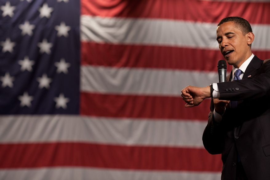 President Barack Obama checks how much time he has left during a health care reform town hall meeting at Southwest High School in Green Bay, Wisconsin, June 11, 2009. (Official White House Photo by Pete Souza)