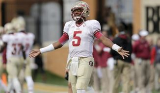 Florida State quarterback Jameis Winston watches on the sidelines as his team plays Wake Forest in the first half of an NCAA college football game in Winston-Salem, N.C., Saturday, Nov. 9, 2013. Florida State won 59-3. (AP Photo/Nell Redmond)