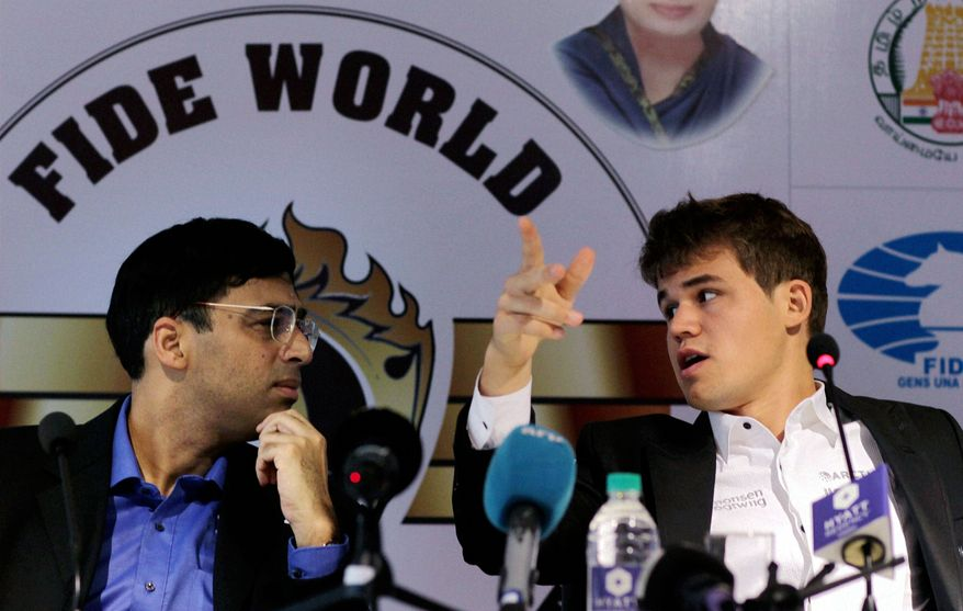 Defending champion India's Viswanathan Anand, left, listens to Norway's Magnus Carlsen during a press conference on the sidelines of the World Chess Championship in Chennai, India, Saturday, Nov. 9, 2013. The first game between the two ended in a draw. (AP Photo)
