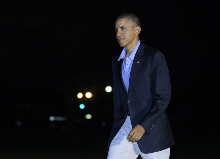 President Barack Obama walks from Marine One on the South Lawn after returning to the White House in Washington, Saturday, Nov. 9, 2013, from a trip to Florida. (AP Photo/Susan Walsh)